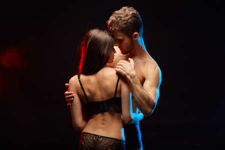 Photo pour awesome man and woman having healthy sexual relationship. close up photo. isolated black background - image libre de droit