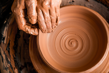 Photo pour Potter shaping clay on the pottery wheel - image libre de droit