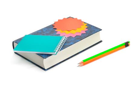 Foto de Book, pencils, notebook and stickers isolated on white background - Imagen libre de derechos