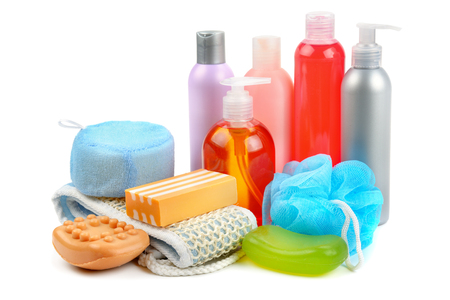 Foto de Shampoo, soap and bath sponge isolated on white background. Assortment of personal hygiene items. - Imagen libre de derechos