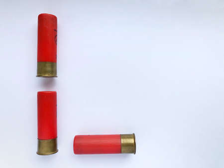 Photo pour Several hunting cartridges and scattered pellets of cartridges isolated on a white background. - image libre de droit