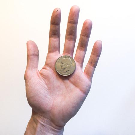 Foto de Hand holding an Eisenhower Dollar - Imagen libre de derechos