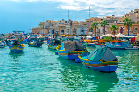 Photo for beautiful view of european harbor with village Marsaxlokk, market and traditional colorful Luzzu fishing boats, Malta - Royalty Free Image