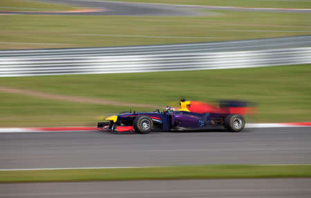 Photo pour  Formula 1.0 race car racing at high speed with motion blur on a racing track  - image libre de droit