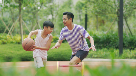 Photo for Chinese father playing basketball with son - Royalty Free Image
