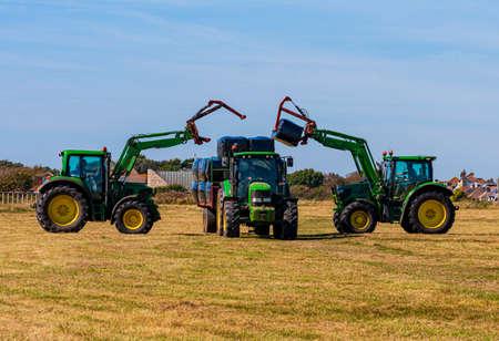 Foto de Grass cutting and Hay making at Hengistbury Head in Dorset - Imagen libre de derechos