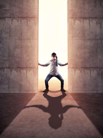 Foto de Businessman pushing a huge concrete gate. - Imagen libre de derechos