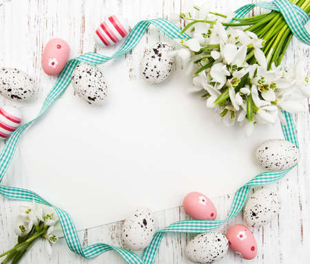 Foto de Easter background with snowdrops, eggs and ribbon - Imagen libre de derechos