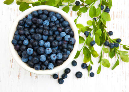 Photo for Bowl with Blueberries on a old wooden background - Royalty Free Image
