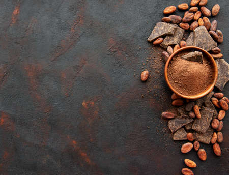 Photo for Natural  cocoa powder and cocoa beans  on a black background - Royalty Free Image