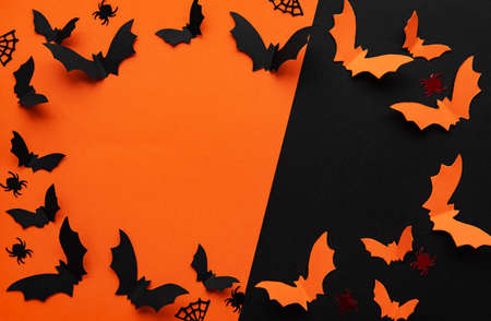 Photo pour holidays  concept - halloween paper decorations  with blank copy space over  orange and black background - image libre de droit
