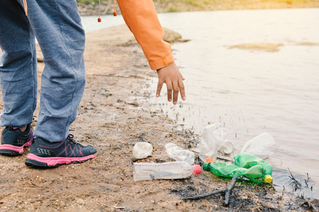 Photo pour Boy picking up empty of bottle plastic ,volunteer concept - image libre de droit