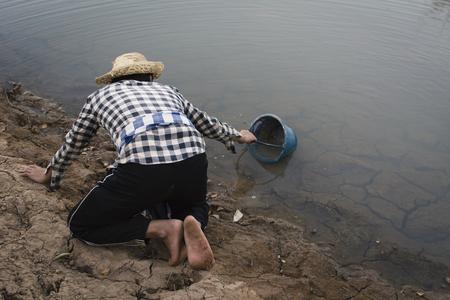 Foto de Asian man on nature ,crisis of water drought concept, selective and soft focus - Imagen libre de derechos