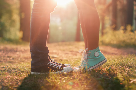 Foto de Young couple kissing in summer sun light. Kiss love standing - Imagen libre de derechos