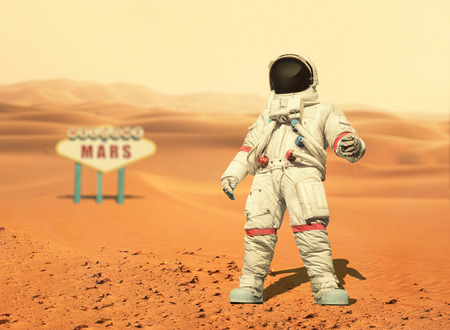 Foto per Spaceman walks on the red planet Mars. Space Mission. Welcome to Mars sign. Astronaut travel in space - Immagine Royalty Free