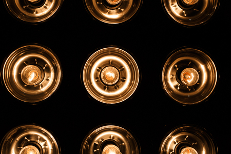 Photo for A group of electric bright orange vintage lamps on a black background. Close up - Royalty Free Image