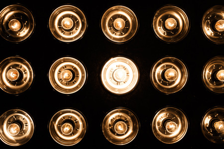 Foto per Beautiful bright electric vintage glass spotlights on a black background. Bright light. Close-up - Immagine Royalty Free