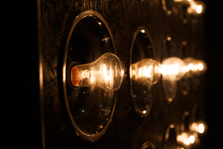 Photo for Electric bright gold vintage incandescent bulbs. Close-up - Royalty Free Image