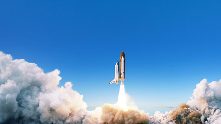 Photo pour Spacecraft takes off into space. The rocket starts in the blue sky. Travel concept - image libre de droit