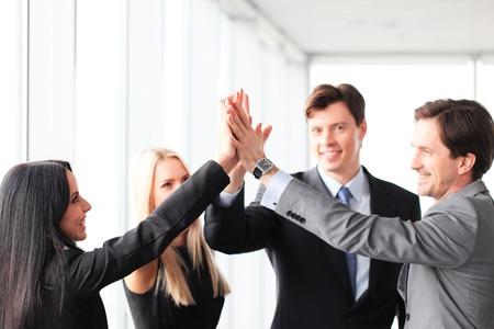 Foto de Happy business people hands giving high five - Imagen libre de derechos