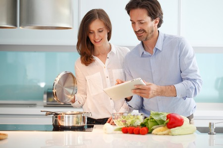 Couple cooking dinner at kitchen
