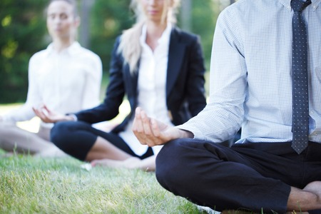 Foto de business people doing yoga at the park - Imagen libre de derechos
