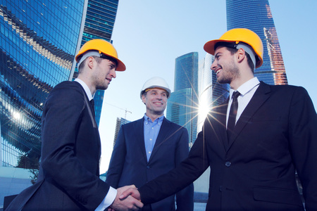Photo pour Investor and contractor shaking hands, view from below - image libre de droit