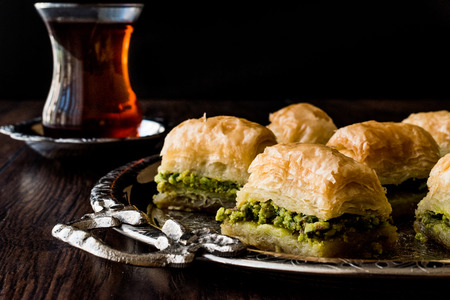 Photo for Turkish Dessert Baklava with tea on silver tray. Desset Concept. - Royalty Free Image