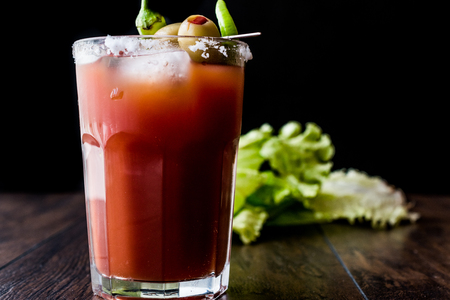 Photo for Bloody Mary Cocktail with green olive, pepper, lettuce, salt and ice. Beverage Concept. - Royalty Free Image