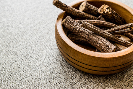 Photo for Dried Licorice Sticks in wooden bowl / Meyan Koku. Organic Concept. - Royalty Free Image