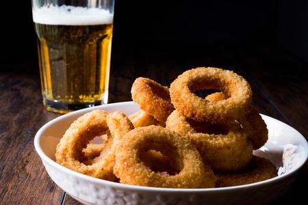 Foto de Homemade Crunchy Fried Onion Rings with Beer. Fast Food. - Imagen libre de derechos