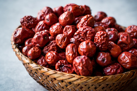 Photo for Red Jujube Fruits in Wooden Basket. Organic Food. - Royalty Free Image