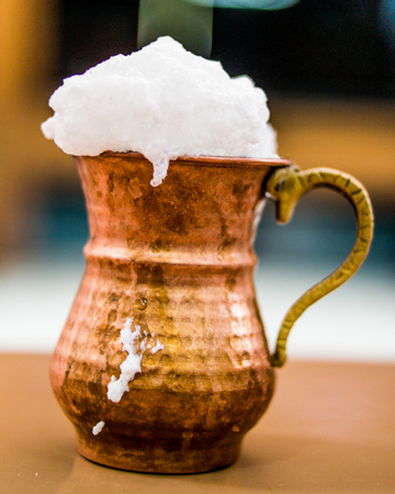 Photo for Turkish Drink Ayran or Buttermilk with foam in copper cup. beverage concept. - Royalty Free Image