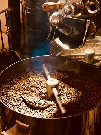 Foto de Freshly Roasted Aromatic Coffee Beans in a Coffee Roasting Machine. Organic Food. - Imagen libre de derechos