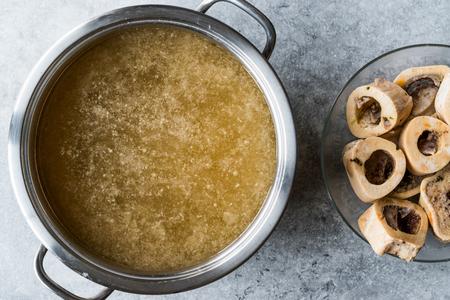 Photo for Bone Broth Bouillon in Metal Pan. Organic Food. - Royalty Free Image