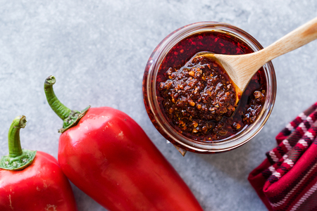 Photo for Hot Mexican Spicy Chili Red Sauce Salsa Macha with Red Pepper Powder in Jar. Traditional Organic Food. - Royalty Free Image