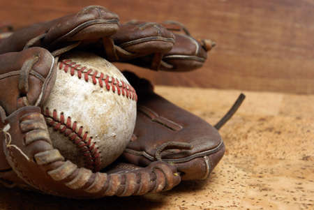 A low contrast image of a well used hardball and glove for those who love the sport of baseb mural