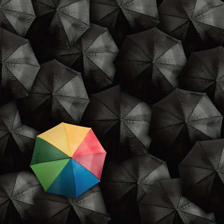 Concept of leader with with many blacks and a colorful umbrella