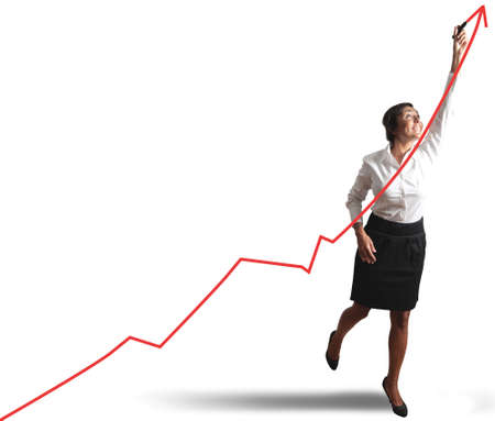 Foto de Businesswoman drawing statistics trend - Imagen libre de derechos