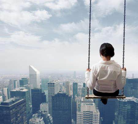 Foto de Freedom business woman on a swing - Imagen libre de derechos