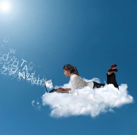 Photo for Concept of a businesswoman that works over a cloud - Royalty Free Image
