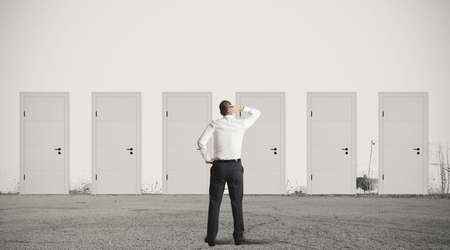 Photo for Concept of businessman choosing the right door - Royalty Free Image