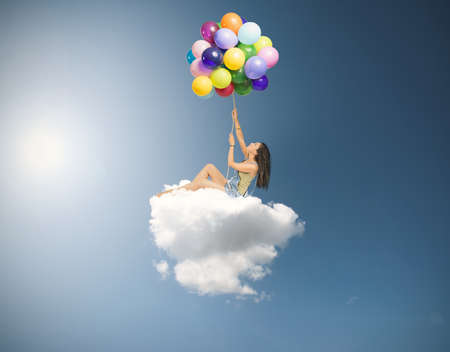 Foto de Girl flies over a soft cloud - Imagen libre de derechos