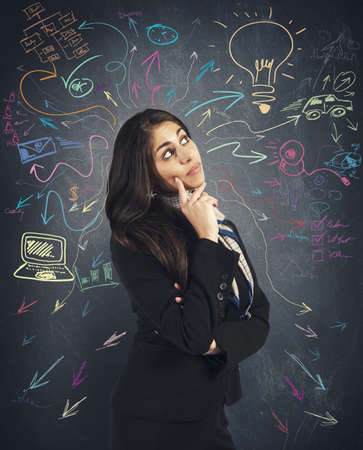 Photo pour Creative business idea of a young businesswoman - image libre de droit