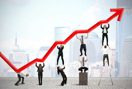 Foto de Teamwork and corporate profit with red statistical trend - Imagen libre de derechos