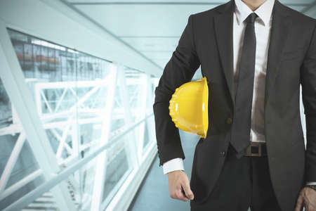 Photo for Ready businessman architect with yellow helmet - Royalty Free Image