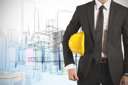 Photo pour Ready businessman architect with yellow helmet - image libre de droit