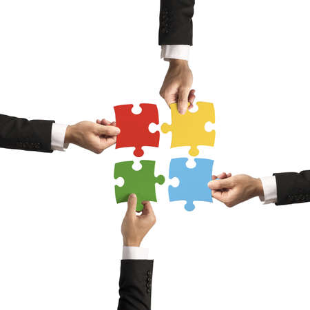 Photo pour Teamwork and partnership concept with puzzle - image libre de droit