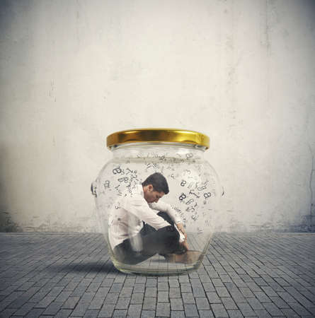 Photo pour Concept of hermetic businessman closed in a jar - image libre de droit