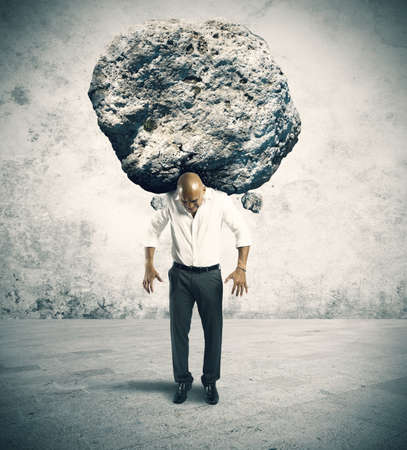 Photo for Concept of stress of a businessman with a big rock - Royalty Free Image